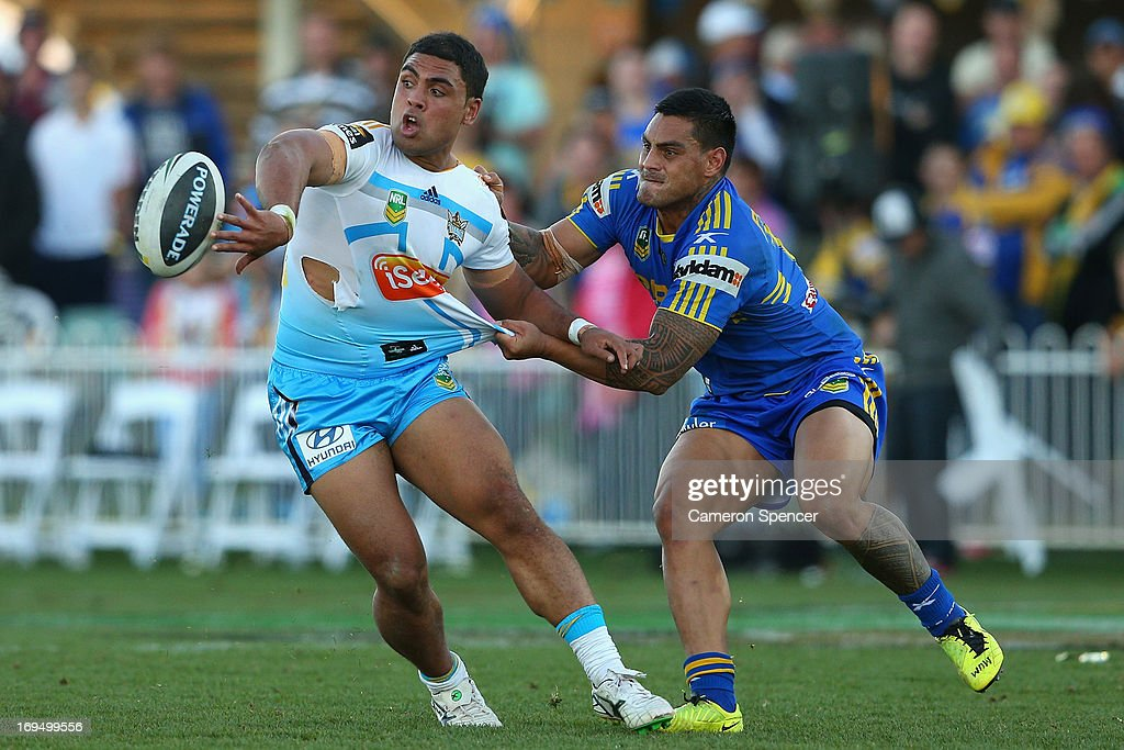 Mark Ioane of the Titans offloads the ball during the round 11 NRL match between the Parramatta Eels and the Gold Coast Titans at Glen Willow Regional Sports Stadium on May 26, 2013 in Mudgee, Australia.