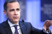 Mark J Carney governor of the central bank of Canada gestures as he speaks during a session on the final day of the World Economic Forum in Davos...