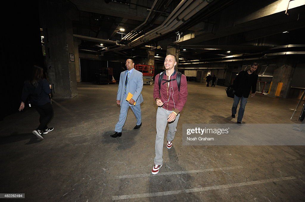 Mark Jackson of the Golden State Warriors and Stephen Curry #30 arrive at the arena before the game against the Los Angeles Clippers at STAPLES Center on March 12, 2014 in Los Angeles, California.