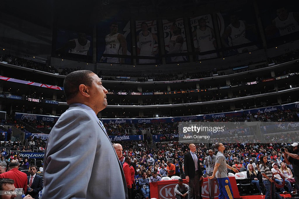 Mark Jackson of the Golden State Warriors looks on during the performance of the National Anthem before facing the Los Angeles Clippers at Staples Center on March 12, 2014 in Los Angeles, California.