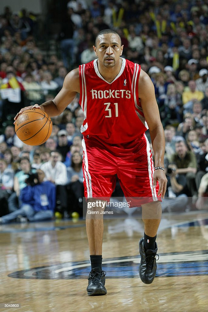 Mark Jackson #31 of the Houston Rockets moves the ball during the game against the Dallas Mavericks at the American Airlines Arena on February 21, 2004 in Dallas, Texas. The Mavericks won 97-88.