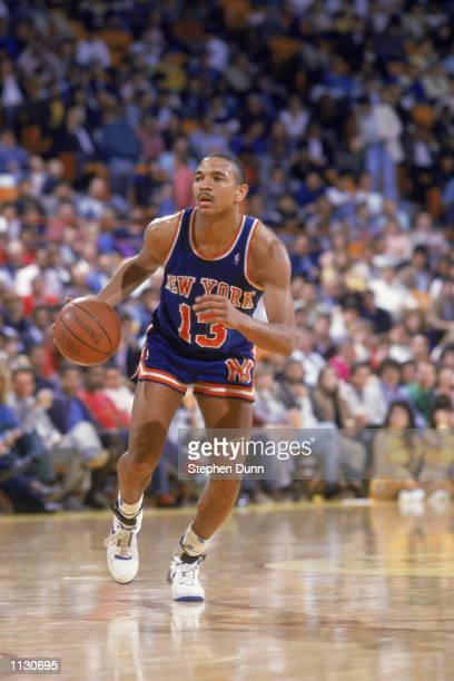 Mark Jackson of the New York Knicks dribbles the ball during an NBA game against the Los Angeles Lakers at the Great Western Forum in Los Angeles...