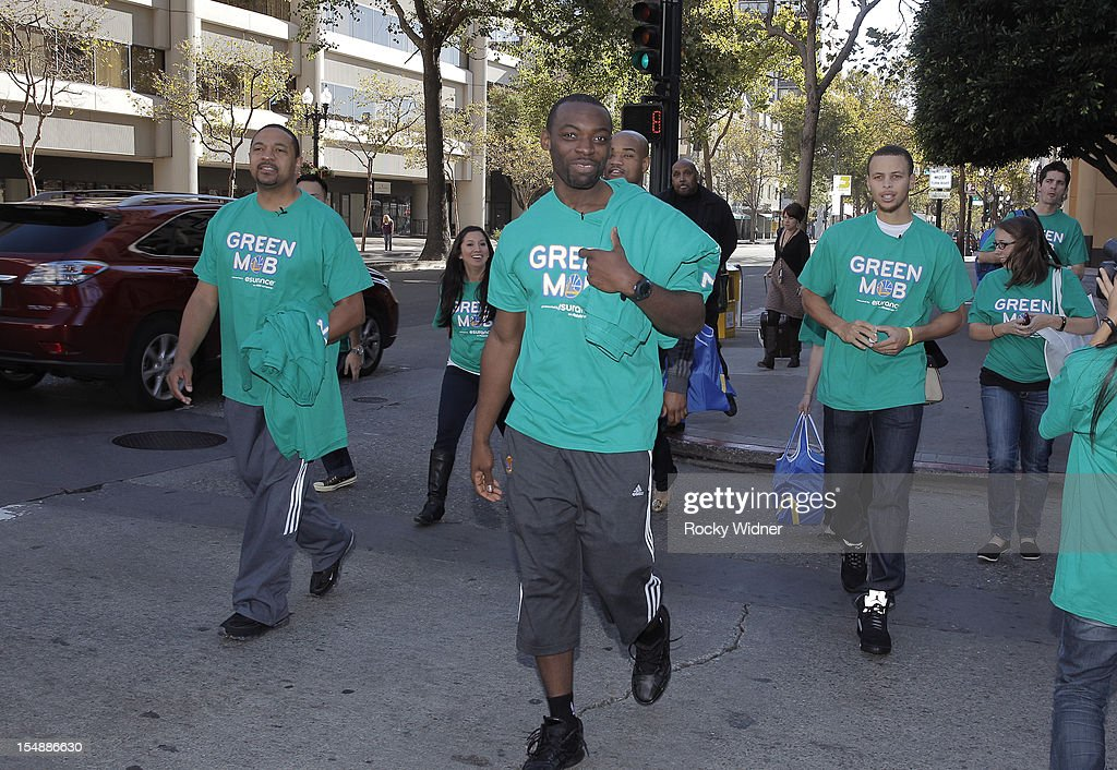 Mark Jackson,Charles Jenkins, and Stephen Curry of the Golden State Warriors hit the street to meet fans on October 26, 2012 in Oakland, California.