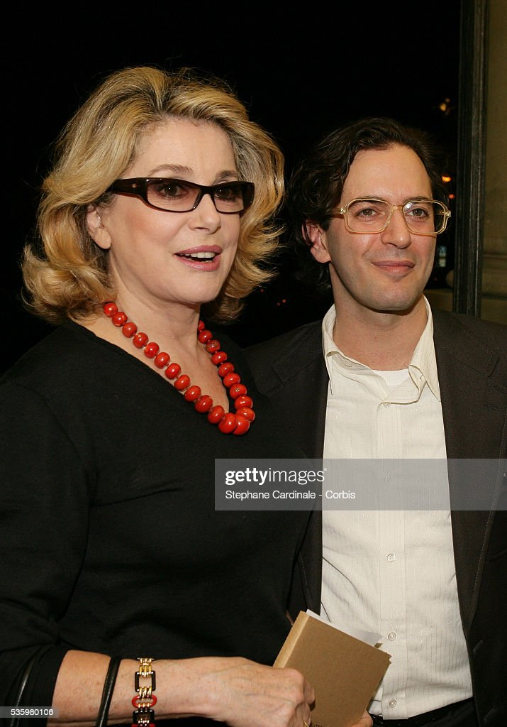 Mark Jacobs and Catherine Deneuve at the 'Louis Vuitton ready-to-wear Spring-Summer 2006 collection' fashion show.