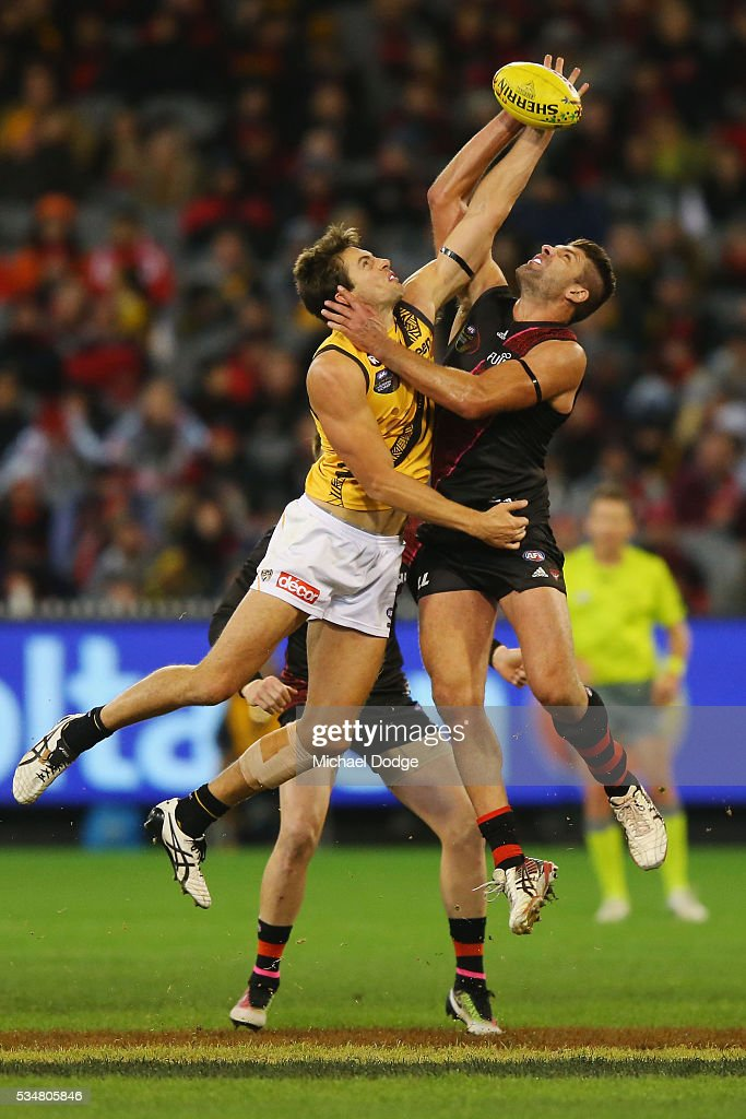Mark Jamar of the Bombers (R) and Shaun Hampson of the Tigers compete for the ball during the round 10 AFL match between the Essendon Bombers and the Richmond Tigers at Melbourne Cricket Ground on May 28, 2016 in Melbourne, Australia.
