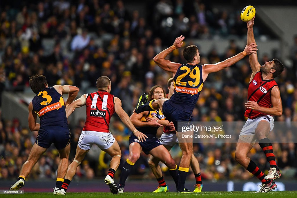 Mark Jamar of the Bombers contests a ruck with Scott Lycett of the Eagles during the 2016 AFL Round 14 match between the West Coast Eagles and the Essendon Bombers at Domain Stadium on June 30, 2016 in Perth, Australia.