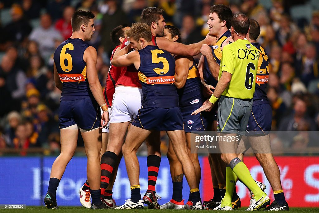 Mark Jamar of the Bombers wrestles with Jeremy McGovern of the Eagles during the round 15 AFL match between the West Coast Eagles and the Essendon Bombers at Domain Stadium on June 30, 2016 in Perth, Australia.
