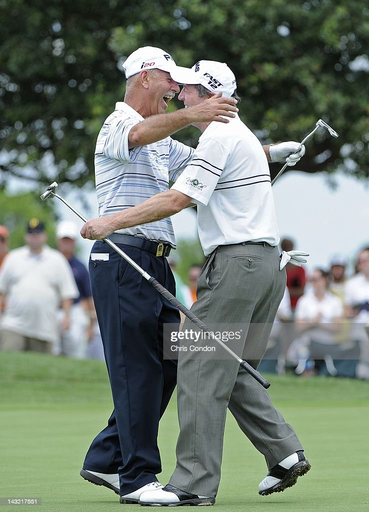 Mark James of England and Des Smyth of Ireland celebrate after winning the Raphael Division at the Liberty Mutual Legends of Golf at The Westin...