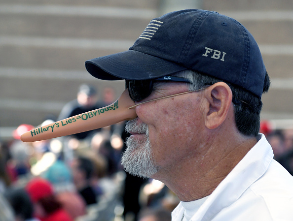 Mark James of Nevada a supporter of Republican presidential nominee Donald Trump wears a Pinocchiothemed nose during a campaign rally at the...