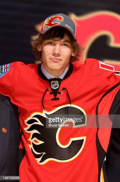 Mark Jankowski 21st overall pick by the Calgary Flames poses on stage during Round One of the 2012 NHL Entry Draft at Consol Energy Center on June 22...