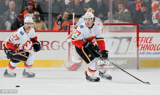 Mark Jankowski and Dougie Hamilton of the Calgary Flames skate after the loose puck against the Philadelphia Flyers on November 18 2017 at the Wells...