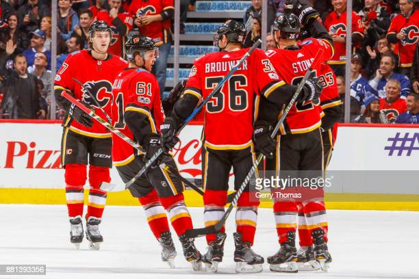Mark Jankowski Brett Kulak Troy Brouwer Michael Stone and Sam Bennett of the Calgary Flames celebrate in an NHL game against the Toronto Maple Leafs...