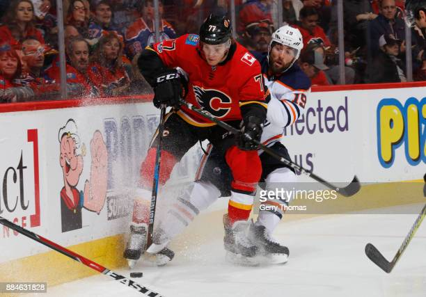 Mark Jankowski of the Calgary Flames battles for the puck against Patrick Maroon of the Edmonton Oilers at Scotiabank Saddledome on December 2 2017...