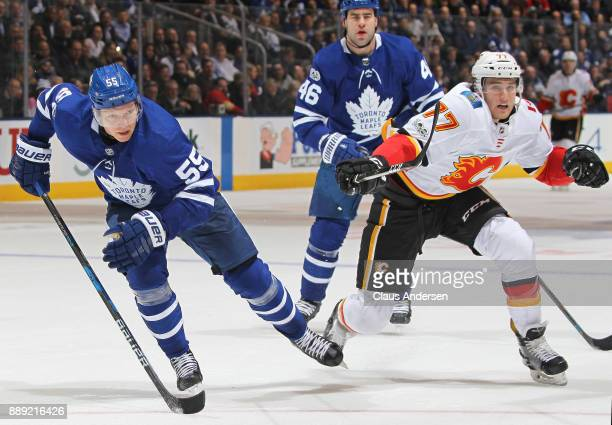 Mark Jankowski of the Calgary Flames skates against Andreas Borgman of the Toronto Maple Leafs during an NHL game at the Air Canada Centre on...