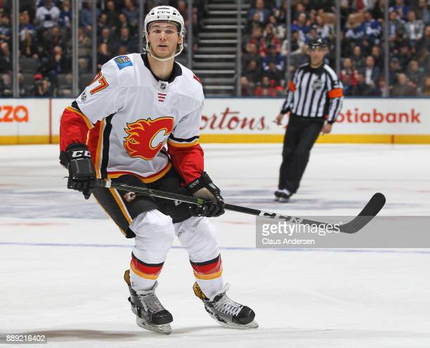 Mark Jankowski of the Calgary Flames skates against the Toronto Maple Leafs during an NHL game at the Air Canada Centre on December 6 2017 in Toronto...