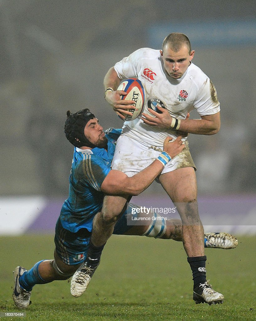Mark Jennings of England is tackled by Vittorio Marazzi of Italy during the International match between England U20 and Italy U20 at Franklin's Gardens on March 8, 2013 in Northampton, England.