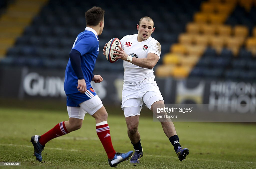 Mark Jennings (R) of England runs at the French defence during the U20s RBS Six Nations match between England U20 and France U20 at the Sixways Stadium on February 23, 2013 in Worcester, England.