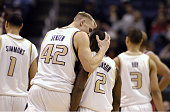 Mark Jensen of Washington consoles Nate Robinson after the point guard picked up his fourth foul during 6663 victory over Stanford in the Pacific...