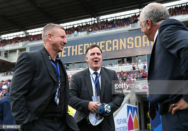 Mark Jones coach of the Jets Laurie McKinna and Graham Arnold coach of Sydney FC during the round four ALeague match between the Newcastle jets and...