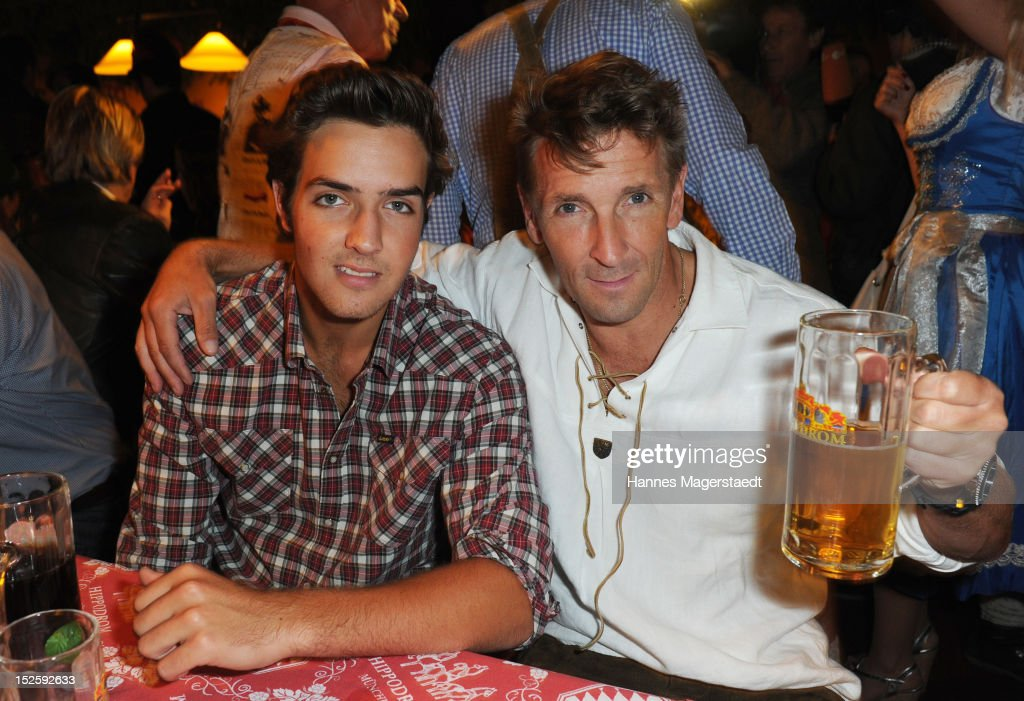 Mark Keller (R) and his son Aaron Keller attend the Oktoberfest beer festival at Hippodrom on September 22, 2012 in Munich, Germany.