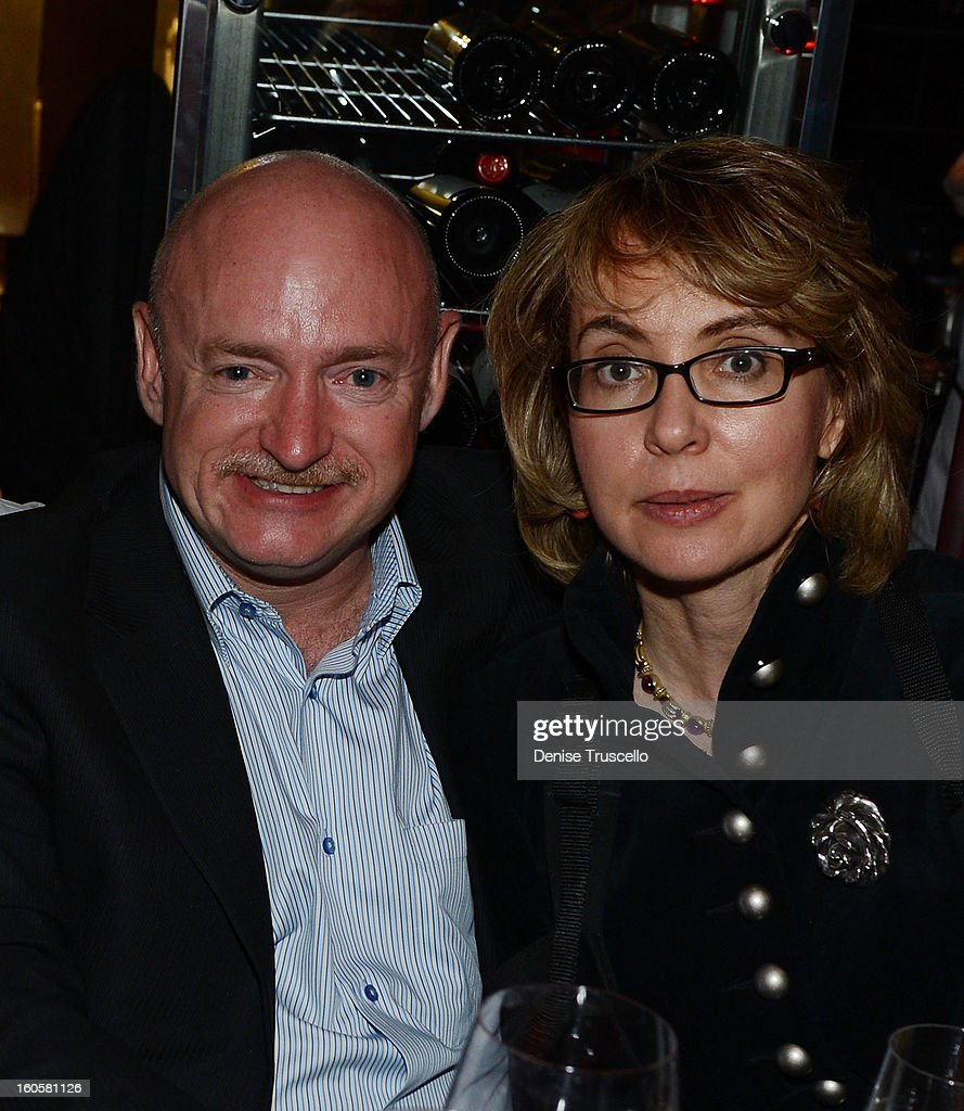 Mark Kelly and Gabrielle Giffords attend the grand opening of SHe by Morton's at Crystals at CityCenter on February 2, 2013 in Las Vegas, Nevada.