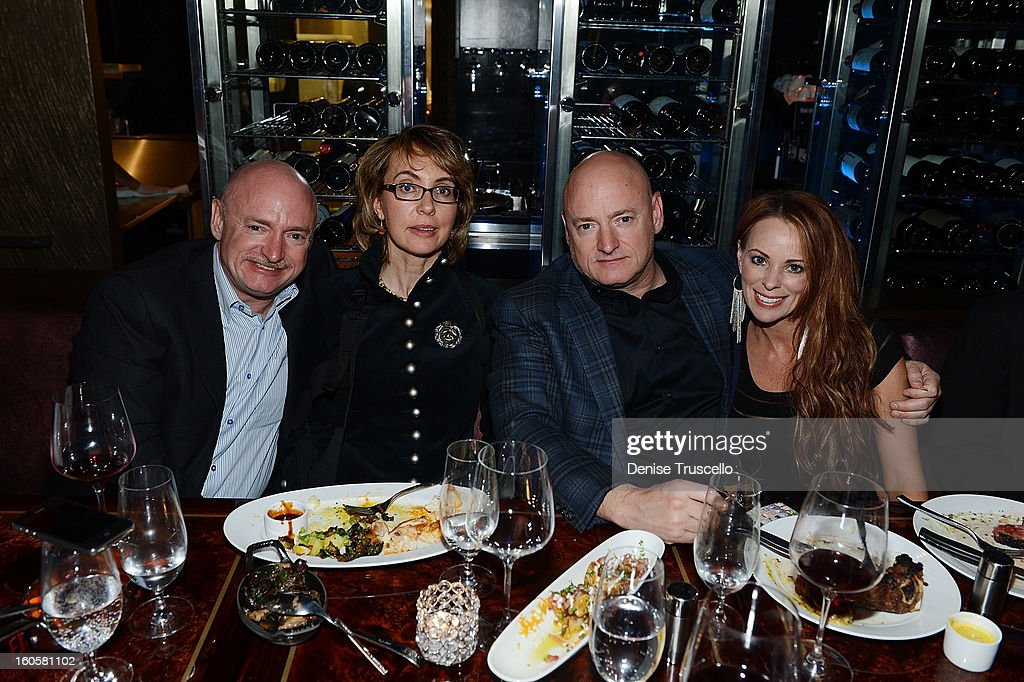 Mark Kelly, Gabrielle Giffords, Scott Kelly and Amiko attend the grand opening of SHe by Morton's at Crystals at CityCenter on February 2, 2013 in Las Vegas, Nevada.Ê