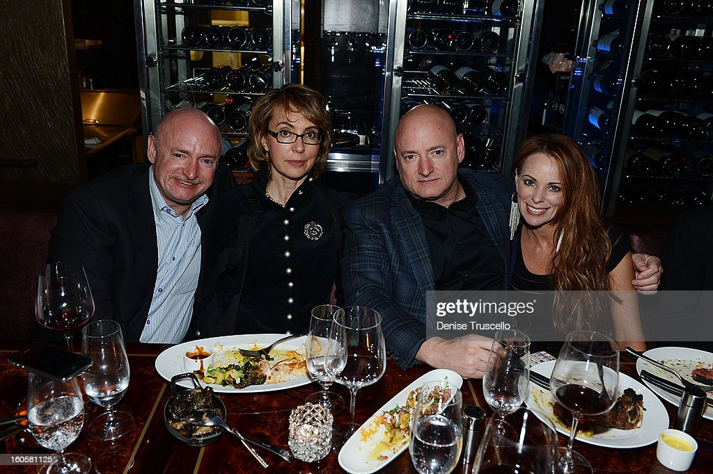 Mark Kelly, Gabrielle Giffords, Scott Kelly and Amiko attend the grand opening of SHe by Morton's at Crystals at CityCenter on February 2, 2013 in Las Vegas, Nevada.