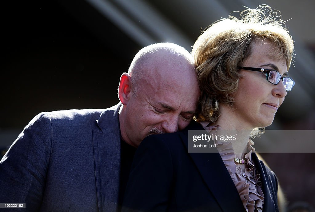 <a gi-track='captionPersonalityLinkClicked' href=/galleries/search?phrase=Mark+Kelly+-+Astronaut+and+Gun+Control+Advocate&family=editorial&specificpeople=566699 ng-click='$event.stopPropagation()'>Mark Kelly</a> leans his head on the shoulder of his wife and former Congresswoman Gabby Giffords as they attend a news conference asking Congress and the Senate to provide stricter gun control in the United States on March 6, 2013 in Tucson, Arizona. Giffords and Kelly were joined by survivors of the Tucson shooting as they spoke outside the Safeway grocery store where the shooting happened two years ago where six people were killed.