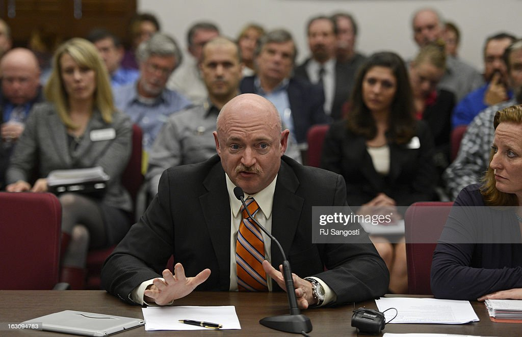 Mark Kelly, the husband of former U.S. Rep. Gabrielle Giffords, testified before Colorado lawmakers on a universal background check bill for private gun sales, March, 04, 2013, at the Colorado State Capitol. Kelly addressed the Senate State, Veterans, and Military Affairs Committee in support of House Bill 1229.