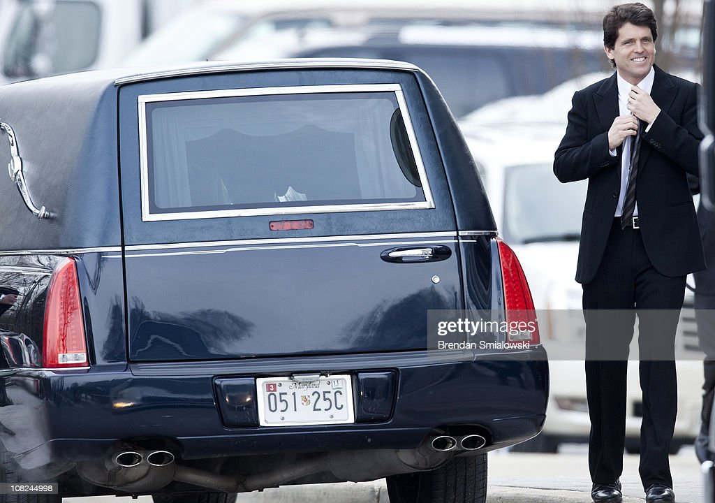 Mark Kennedy Shriver walks to the back of a hearse before the funeral of Sargent Shriver at Our Lady of Mercy Catholic Church January 22, 2011 in Potomac, Maryland. Robert Sargent Shriver Jr., a politician and activist who was the first leader of the Peace Corps and was involved in other social programs, died this week at the age of 95.