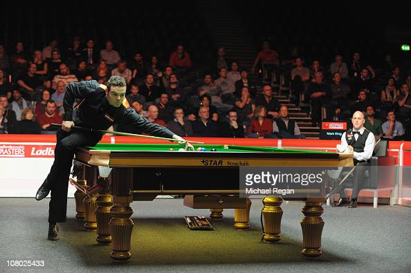 Mark King of England looks on as Jamie Cope of England plays a shot during the Ladbrokesmobile Masters quarterfinal match at Wembley Arena on January...