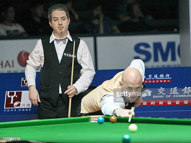 Mark King of England plays a shot in the match against Anthony Hamilton of England on day five of the 2011 World Snooker Shanghai Masters at Shanghai...