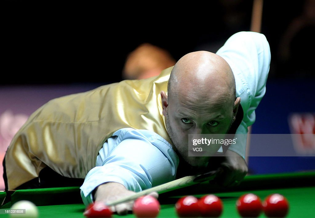 <a gi-track='captionPersonalityLinkClicked' href=/galleries/search?phrase=Mark+King+-+Snooker+Player&family=editorial&specificpeople=4534474 ng-click='$event.stopPropagation()'>Mark King</a> of England plays a shot in the match against Neil Robertson of Australia on day four of the 2013 World Snooker Shanghai Master at Shanghai Grand Stage on September 19, 2013 in Shanghai, China.