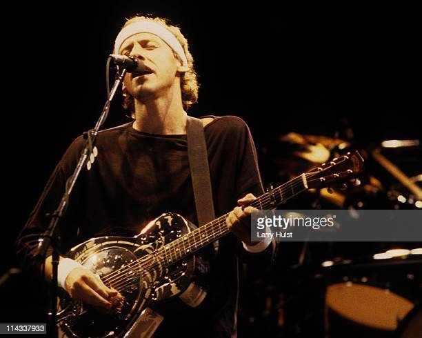 Mark Knopfler performing with 'Dire Straits' in Oakland Colisieum in Oakland California on Febuary 2 1992
