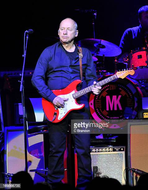 Mark Knopfler performs on stage at Royal Albert Hall on May 27 2013 in London England