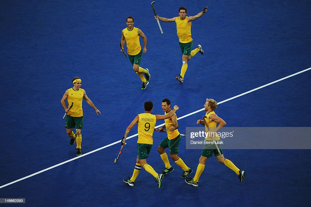 <a gi-track='captionPersonalityLinkClicked' href=/galleries/search?phrase=Mark+Knowles&family=editorial&specificpeople=217246 ng-click='$event.stopPropagation()'>Mark Knowles</a> of Australia celebrates after scoring during the Men's Hockey match between Australia and Great Britain on Day 9 of the London 2012 Olympic Games at Riverbank Arena Hockey Centre on August 5, 2012 in London, England.
