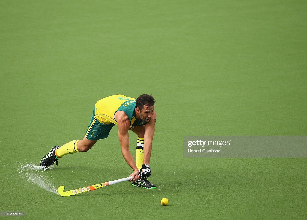 <a gi-track='captionPersonalityLinkClicked' href=/galleries/search?phrase=Mark+Knowles&family=editorial&specificpeople=217246 ng-click='$event.stopPropagation()'>Mark Knowles</a> of Australia plays a shot during the Men's preliminaries match between South Africa and Australia at Glasgow National Hockey Centre during day five of the Glasgow 2014 Commonwealth Games on July 28, 2014 in Glasgow, United Kingdom.