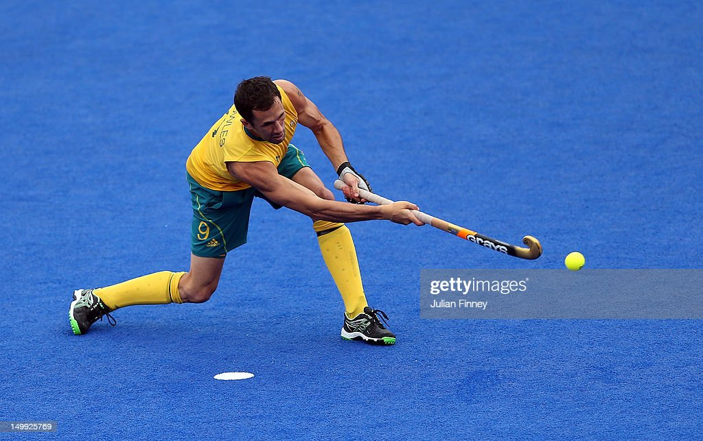 <a gi-track='captionPersonalityLinkClicked' href=/galleries/search?phrase=Mark+Knowles&family=editorial&specificpeople=217246 ng-click='$event.stopPropagation()'>Mark Knowles</a> of Australia scores a penalty during the Men's Hockey match between Australia and Pakistan on Day 11 of the London 2012 Olympic Games at Riverbank Arena Hockey Centre on August 7, 2012 in London, England.