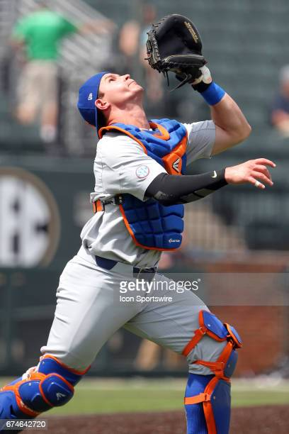Mark Kolozsvary of the Gators looks for the pop up during the college baseball game between the Florida Gators and the Vanderbilt Commodores on April...
