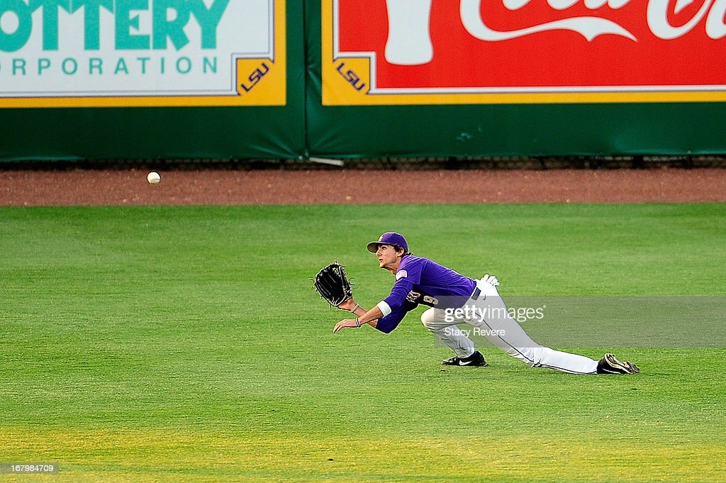 Mark Laird #9 of the LSU Tigers makes a diving catch against the Florida Gators during a game at Alex Box Stadium on May 3, 2013 in Baton Rouge, Louisiana.
