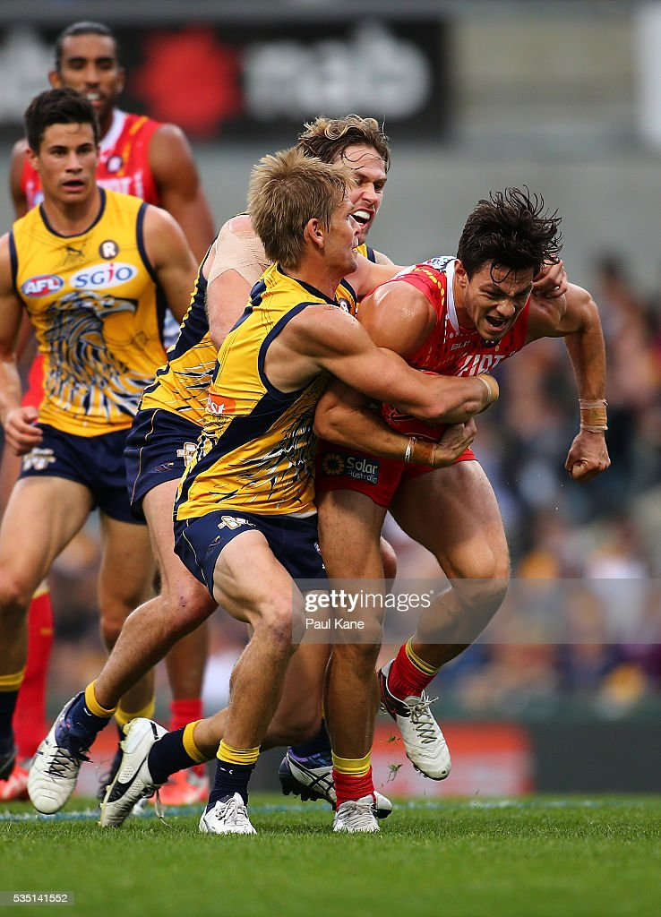 <a gi-track='captionPersonalityLinkClicked' href=/galleries/search?phrase=Mark+LeCras&family=editorial&specificpeople=747453 ng-click='$event.stopPropagation()'>Mark LeCras</a> and Mark Hutchings of the Eagles tackle Jesse Lonergan of the Suns during the round 10 AFL match between the West Coast Eagles and the Gold Coast Suns at Domain Stadium on May 29, 2016 in Perth, Australia.