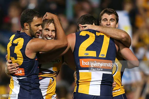 Mark LeCras of the Eagles celebrates a goal with Josh Hill Jack Darling and Jamie Cripps during the AFL Second Preliminary Final match between the...