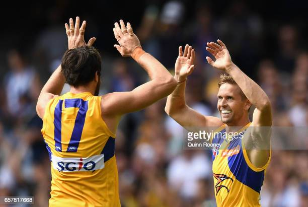 Mark LeCras of the Eagles is congratulated by Josh Kennedy of the Eagles after kicking a goal during the round one AFL match between the North...