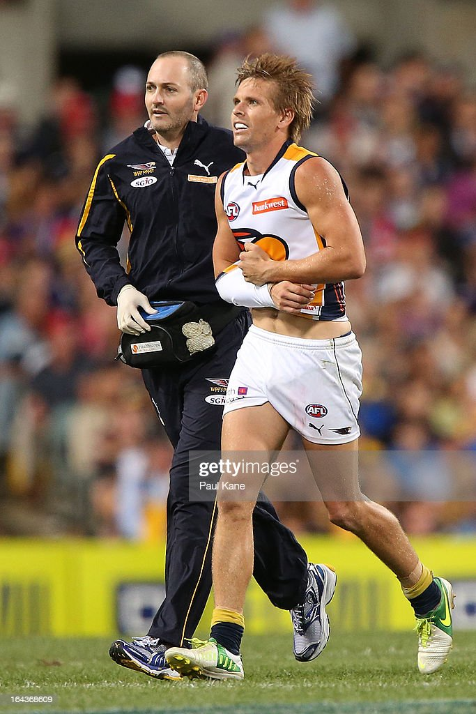 <a gi-track='captionPersonalityLinkClicked' href=/galleries/search?phrase=Mark+LeCras&family=editorial&specificpeople=747453 ng-click='$event.stopPropagation()'>Mark LeCras</a> of the Eagles leaves the field with an arm injury during the round one AFL match between the Fremantle Dockers and the West Coast Eagles at Patersons Stadium on March 23, 2013 in Perth, Australia.
