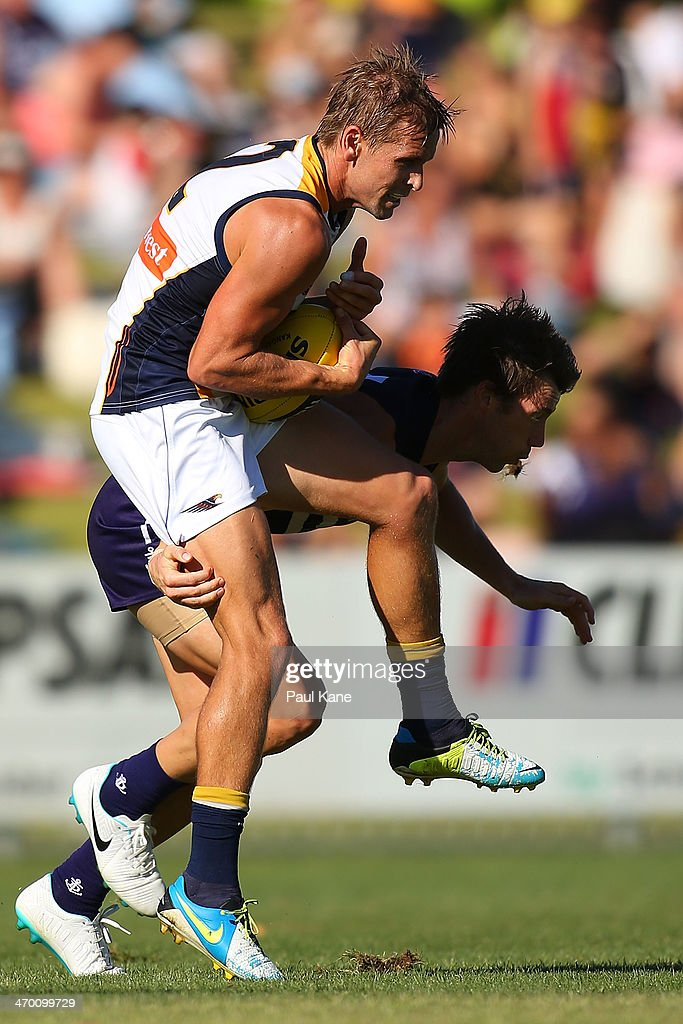 <a gi-track='captionPersonalityLinkClicked' href=/galleries/search?phrase=Mark+LeCras&family=editorial&specificpeople=747453 ng-click='$event.stopPropagation()'>Mark LeCras</a> of the Eagles marks the ball during the round two NAB Challenge Cup AFL match between the Fremantle Dockers and the West Coast Eagles at Arena Joondalup on February 18, 2014 in Perth, Australia.