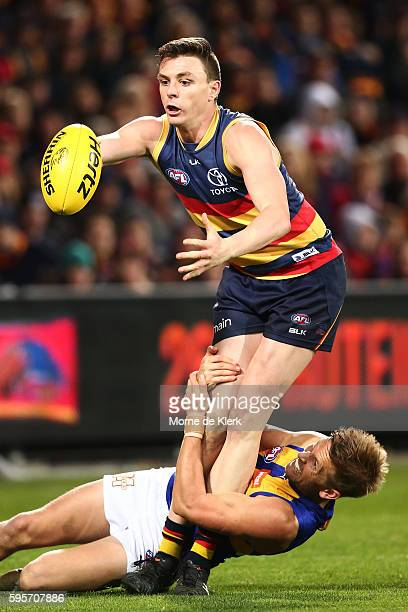 Mark LeCras of the Eagles tackles Jake Lever of the Crows holding the ball during the round 23 AFL match between the Adelaide Crows and the West...