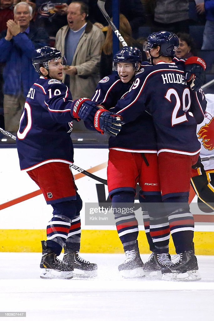 Mark Letestu #10 and Nick Holden #29 congratulate Matt Calvert #11 of the Columbus Blue Jackets on scoring a goal during the first period on February 7, 2013 at Nationwide Arena in Columbus, Ohio.