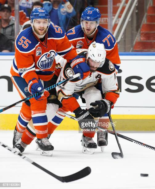 Mark Letestu and Oscar Klefbom of the Edmonton Oilers defend against Ryan Kesler of the Anaheim Ducks in Game Four of the Western Conference Second...