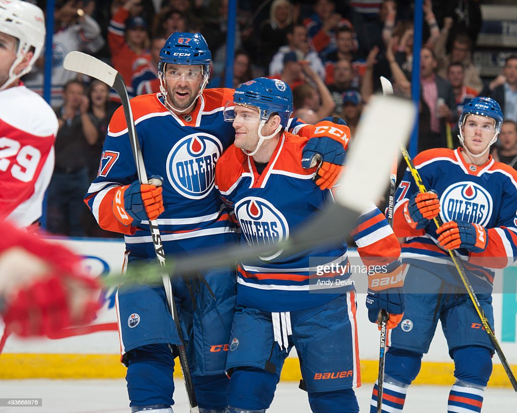 Mark Letestu celebrates with Benoit Pouliot of the Edmonton Oilers after scoring a goal against the Detroit Red Wings on October 21 2015 at Rexall...