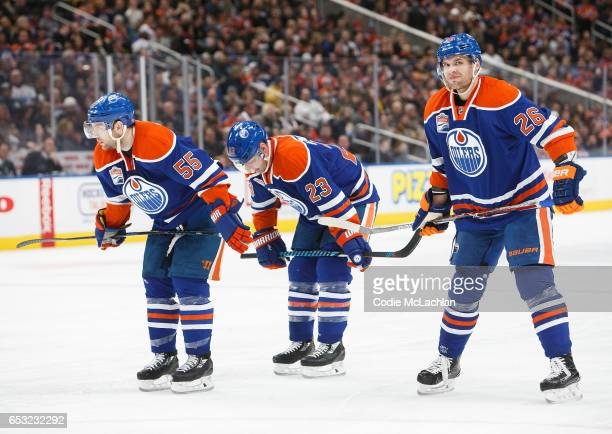 Mark Letestu Matt Hendricks and Iiro Pakarinen of the Edmonton Oilers skate against the Pittsburgh Penguins on March 10 2017 at Rogers Place in...